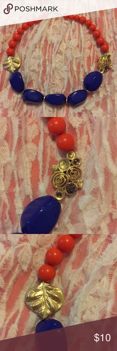 """Orange and navy necklace Bright, chunky necklace in a creamy orange and deep lapis blue, with soft gold accents and clasp.  18 1/2"""" long, plus a 3 1/2"""" extender. NWOT. Never worn. Boutique Jewelry Necklaces"""