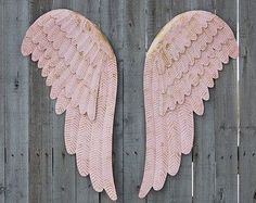 Shabby chic set of large hand painted metal angel wings. Done in soft cottage white and accented in silver with a protective coating. They each have 3 sawtooth hangers on the back and can be hung several different ways. The perfect addition to your home or nursery decor!  Each is 23.5 tall and 9 wide  I mix my own colors and can paint these any color you choose.  *More angel wings - https://www.etsy.com/shop/TheVintageArtistry/search?search_query=wings  All orders are shipped USPS Priority…