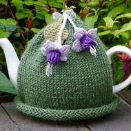 Fuchsias are one of my favourite flowers and I have made a pretty tea cosy with these flowers attached.  There are two fuchsias on the front and one on the back and they are crocheted using purple and lilac cotton. There is a green knitted leaf on the ...
