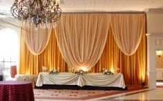 Gold Backdrop with Full Valance, elegant curtain design. Fabric Backdrop, Draped Fabric, Two Tone Curtains, Decoration Hall, Elegant Party Decorations, Altar Decorations, Centerpieces, Draping Techniques, Pipe And Drape