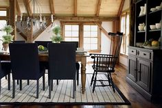 I love all the exposed wood. I need some reclaimed wood floors. Wouldn't this look better with white furniture???