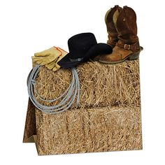 Our Western 3D Centerpiece features a cowboy hat and boots along with gloves and a rope sitting atop hay bales. The western centerpiece measures 9 1/2 tall x 7 3/4 wide. Use this Western 3d Centerpieces to transform your tables into the wild west. Cowboy Centerpieces, Party Table Centerpieces, Rodeo Birthday, Cowboy Birthday Party, Farm Birthday, Birthday Ideas, 70th Birthday, Country Birthday, Pirate Party
