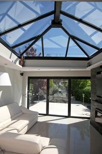 aluminium bifold door with matching roof lantern - not sure about the colour maybe white?