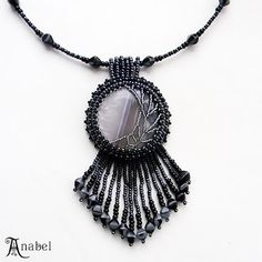 Beaded cabochon with asymmetrical netting.