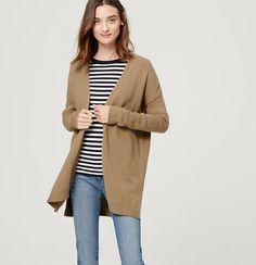 Cut slouchy, this super soft cotton and wool classic gets a twist of modern cool. Long sleeves. Open front. Drop shoulders. Side slits. Ribbed cuffs and hem.