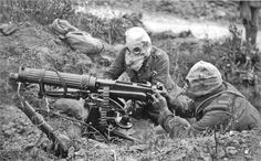 British Vickers machine gun crew wearing PH-type anti-gas helmets. Near Ovillers during the Battle of the Somme, July 1916.