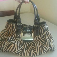 Guess Guess zebra striped tan and black bag extremely extremely cute has been used has some pin marking in the inside shown in pictures two and three still has a lot of life in it comes from a smoke free clean home Guess  Bags Shoulder Bags
