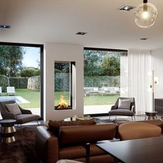 This see-through fireplace is unique in its kind and gets outside in. The ideal fireplace to connect your living room to your garden and make no concessions to your view. Two Sided Fireplace, Double Sided Fireplace, Open Fireplace, Living Room With Fireplace, Fireplace Design, Fireplace Modern, Fireplace Kitchen, Style At Home, House Extension Design