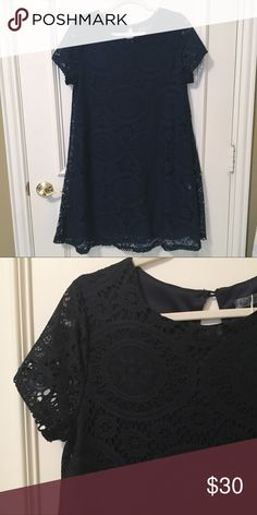 "Navy Lace Swing Dress Navy lace swing dress in size Large. Length is 36"".  Very flattering ""A"" line silhouette. 100% polyester, machine washable. Dress is fully lined.  Excellent condition. Never worn. C Apparel Dresses"