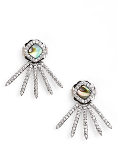 The spiky drops on these on-trend ear jackets fan from behind the earlobe instead of the front, adding intriguing dimension to these delicately glittering earrings.