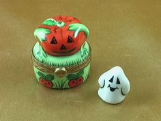 http://www.limogesfactory.com/limoges-boxes-and-figurines/mini-pumpkin-w-ghost-P4433.html Mini pumpkin w/ghost