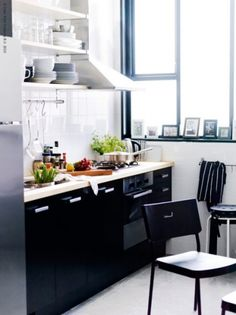 small kitchen black and white with some bright colour. windows <3. Ikea