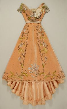 Jacques Doucet, Ball Gown of Embroidered Peach Silk Velvet with Metallic Floral Decoration. Paris, 1898-1900.