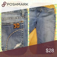 Distressed Joes Jeans Light colored denim slightly distressed bootcut with the leather Joe's Jeans emblem and white stitching around the pockets. Joe's Jeans Jeans Boot Cut