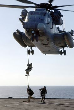 Photo of a Pavelow helicopter hovering as Navy SEALs fast-rope down to a ship's deck. Special Ops, Special Forces, Military Helicopter, Military Aircraft, Us Navy Seals, United States Navy, Military Life, Submarines, Modern Warfare