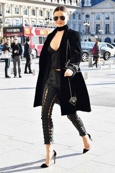 Miranda Kerr street style with black coat, leather pants and crop top