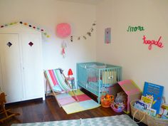 Kids room. Nursery with aqua crib and colorful bunting flags.