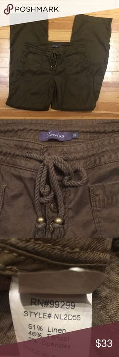 Level 99 Pants Brown drawstring, three button flared leg casual pants. These pants have been washed and lightly pressed although you wouldn't know that looking at the photos. They are light weight and perfect for spring! Let me know if you have any questions! Smoke free home. Level 99 Pants Boot Cut & Flare