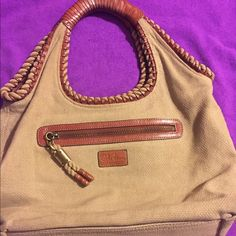 """Cole Hahn Leather and Canvas Hobo Beautiful Cole Haan Hobo Tote bag. Canvas with brown leather piping, handles. Large outside zip pocket. Inside zip pocket, 2 cell phone pockets and 2 pen holders. Zip top close. Bag measures 16"""" x 13.5"""" x 6"""". This is an excellent bag for travel or work. Used once- excellent condition. Cole Haan Bags Hobos"""