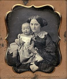 Young mother with baby c. 1855.