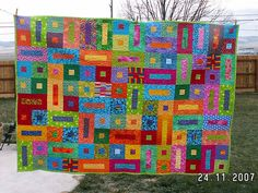 For inspiration: Bricks & Stepping Stones Quilt (no instructions). Cheerful, colorful pattern, and a great way to use up fabric scraps in a variety of sizes, colors and patterns. Again, I'd like to make with soft cotton knits recycled from t-shirts, etc.
