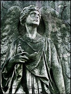 stone angel from brompton cemetery, london england.