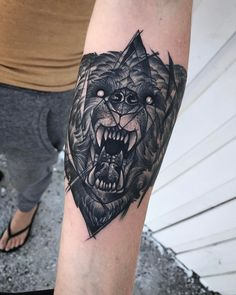 Fun geometric Bear head tattoo by @jpresleytattoos