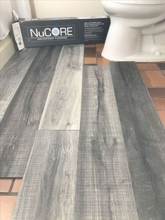 Vinyl plank flooring thats waterproof. Lays right on top of your existing floor. Love this color were using in our bathroom remodel.