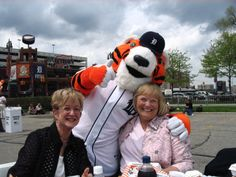 Getting a hug from PAWS before a Detroit Tigers game in Detroit, MI.