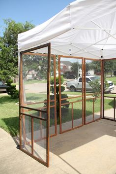 Adri's Art: Art Fair booth screen doors hinged together could be a good option. You could hang things and since the wind would blow through less chance of being blown over! - July 07 2019 at