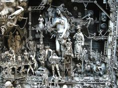 Unwanted toys, frames and plastic model kits are  -  recreated into fantastic sculptures by Kris Kuksi.     By turning old plastic soldiers, dolls and tanks into sculpture, all that plastic is kept out of the landfill, long term.