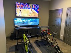 2 wahoo kicker trainers with side-by-side with Zwift. TV above for movies or xbox to make the time go by faster. Home Gym Garage, Gym Room At Home, Garage Studio, Basement Gym, Garage House, Zwift Cycling, Indoor Cycling, Bike Craft, Bike Room