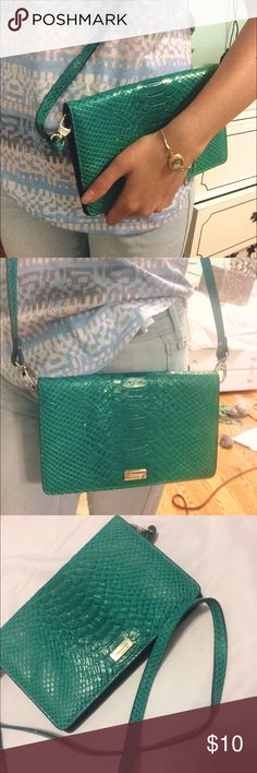"""⏳Teal faux snakeskin purse This is a very small purse good for formal events where you don't need to carry much with you. It is a beautiful teal color and is a faux snake skin pattern. It's never been used. Has 3 pockets (including a phone pocket). Clasps shut. Has a mirror. Measures about 8"""" by 5"""" the only imperfection is a tiny white spot about the size of a pin head. Lodis Bags Crossbody Bags"""
