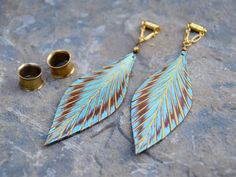 If you miss fun and feminine, dangly earrings, these are the gauges for you! Unique and Gorgeous Hand Painted Teal Leather Feather Magnetic Clasp Gauged Earrings. Huge Selection of Unique plugs and Jewelry. Dangly Earrings, Amethyst Earrings, Beaded Earrings, Diy Gauge Earrings, Feather Jewelry, Feather Earrings, Metal Jewelry, Leaf Earrings, Jewelry Crafts