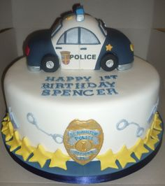 Police car cake with handcuffs, walkie-talkies and edible police badge