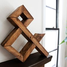 wooden ampersand. this looks DIYable.
