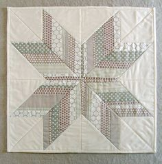 This refreshing take on the lone star quilt pattern will make a gorgeous wall hanging during the holiday season or freshen up your home throughout the year. @purl bee breaks down the steps it takes to make this an easy star quilt pattern that you can personalize with your favorite color scheme.