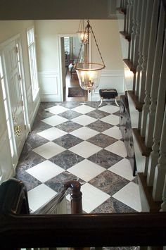New look to a traditional pattern. Put marble squares in a diagonal pattern, makes a bright and elegant entry hall. http:www.designingyourperfecthouse.com