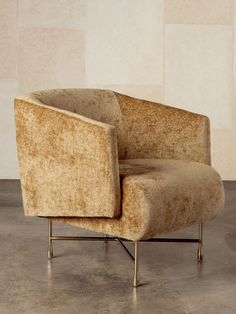 KELLY WEARSTLER | BIJOUX LOUNGE CHAIR. Features a tight upholstered seat and back, with an upright but comfortable seating position, married to a lustrous and architectural burnished brass base