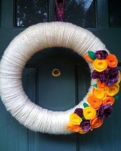 Fall Wreath - love how the colors pop against the white....so so pretty!