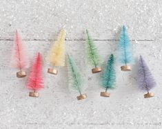 A set of 8 rainbow bottle brush trees for crafts and Christmas decorating. These vintage style miniature sisal trees have been dyed colorful pastel tones. Great for crafts and Christmas decorating. Christmas Ribbon, Little Christmas, Christmas Goodies, Christmas Tree, Pink Lemon, Cotton Crafts, Bottle Brush Trees, Miniature Christmas, Christmas Villages