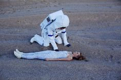 Intergalactic Wedding Photographs by Neringa Rekasiute  Far from conventional pictures Neringa Rekasiute made an insolite photoshoot for this young couple. Influenced by their wedding theme Space Odyssey the photograph and the brides imagined a love story between a young woman and an astronaut from another planet. Discover their beautiful and romantic escape bellow.             #xemtvhay