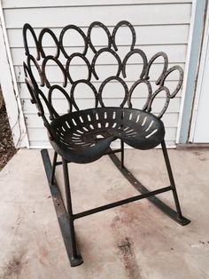 Found on EstateSales.NET: Folk art, cast iron rocking chair from tractor seat and horse shoe back.