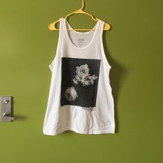 Gorgeous Profound Aesthetic tank! Unique oversized white tank with a beautiful print. Size medium but could fit a large. %100. Selling way reduced because of a few small stains. I haven't spot treated them but am confident they'd come out easily. Make me an offer. This piece is sold out and one of a kind. Profound Aesthetic Tops Tank Tops