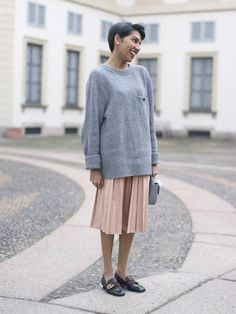 Feminine in a pleated skirt with an oversized sweater  | For more style inspiration visit 40plusstyle.com