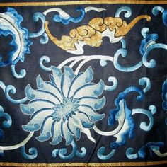 """Detail, c. 1850 Chinese blue and white silk embroidery on navy blue silk border with large flower heads embroidered in Peking knot and bats embroidered in gold thread, surrounded by scrolling vines done in a satin stitch.  38½"""" long x 9"""" wide"""