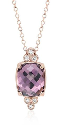 This gemstone pendant features a faceted cushion cabochon cut amethyst, accented with round brilliant cut diamonds in a patent-pending setting of polished 14k rose gold.