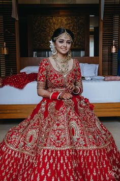 Red bridal lehenga with heavy work paired with light jewelry Indian Wedding Lehenga, Bridal Lehenga Choli, Red Lehenga, Anarkali, Lehenga Blouse, Indian Bridal Outfits, Indian Bridal Fashion, Indian Bridal Wear, Indian Dresses