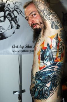 A tattoo artist shows off his Batman tatoo that he received at a stand at the 21st International Tattoo Convention Berlin on December 3, 2011 in Berlin, Germany