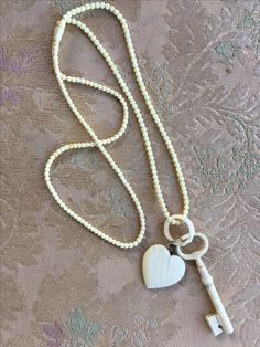 VJR JEWELS . I created this necklace to mix and match the antique ivory treasures , The key is a needle case.€ 225,-